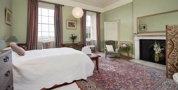 Bedroom 10, king size double with adjoining private shower room in hall. There is a single four-poster bed in the turret for a child.