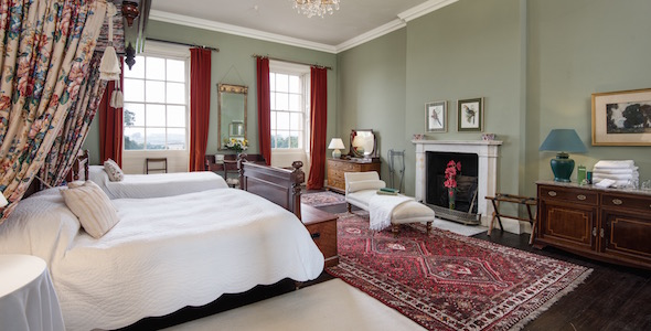 Bedroom 6. A large double or twin room with views over the South lawn. Private shower room adjoining.