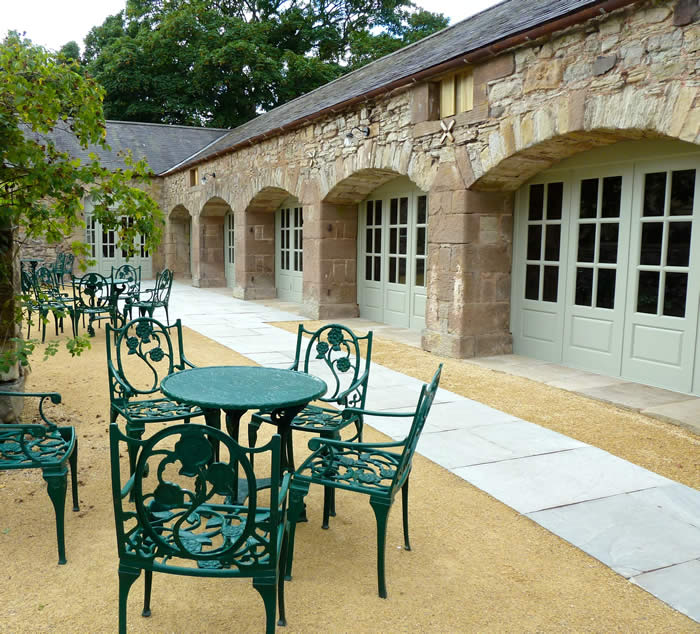 Cart Shed with garden furniture in courtyard