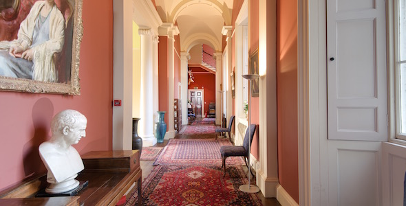 The gallery is reached by the sweeping stone staircase and links the reception rooms
